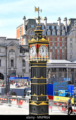 London street scene Victoria train station approach ornate victorian Little Ben cast iron miniature clock tower rising above everlasting road works UK - Stock Photo