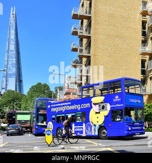Megasightseeing low cost online open top sightseeing tour bus by Stagecoach turning into Tower Bridge Road Shard skyscraper beyond London England UK - Stock Photo