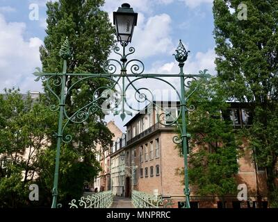 Passerelle des Juifs, Jewish bridge. Ironwork at the end, and across, a canal footbridge, Strasbourg, France - Stock Photo