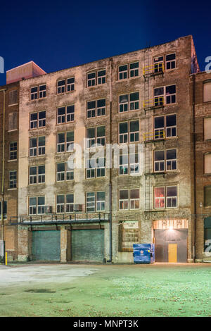Industrial buildings in the West Bottoms at dawn - Stock Photo
