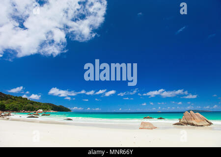 Picturesque Anse Lazio the best beach on tropical Praslin island in Seychelles - Stock Photo