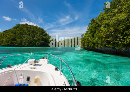 Exploring scenic lagoon of Palau is characterized by hundreds of limestone islands - Stock Photo