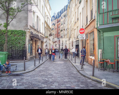 PARIS, FRANCE-MAY 5, 2016: A typical Parisian street in the Latin Quarter - Stock Photo