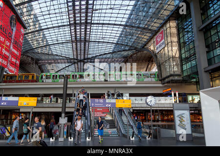 Busy plaform in the central train station Berlin Hauptbahnhof, the largest train station in Europe - Stock Photo
