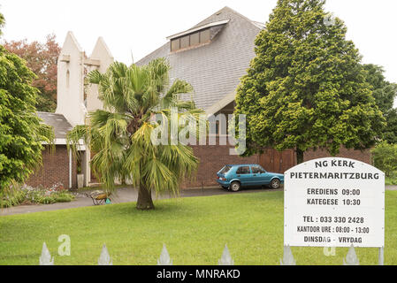 HOWICK, SOUTH AFRICA - MARCH 23, 2018: The Dutch Reformed Church Pietermaritzburg in Merrivale, Howick. Trees, a vehicle and wheelbarrow are visible - Stock Photo