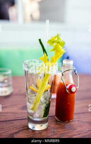 Close up of Bloody Mary cocktail served in a bar or restaurant - Stock Photo