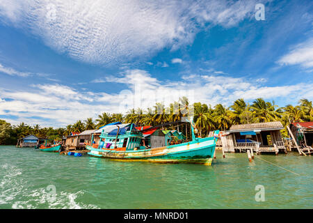 Traditional floating village on Koh Rong island in Cambodia - Stock Photo