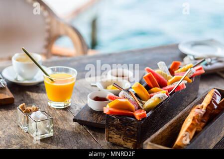 Close up of delicious organic food served for breakfast on rustic wooden table. Fruits,  juice,  bread and jam. - Stock Photo