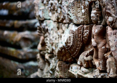 Bas reliefs in Angkor Archeological area in Cambodia - Stock Photo