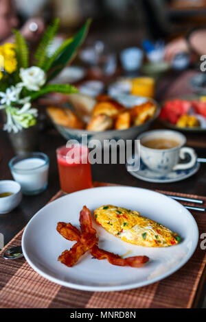 Delicious breakfast with omelet,  bacon and vegetables - Stock Photo