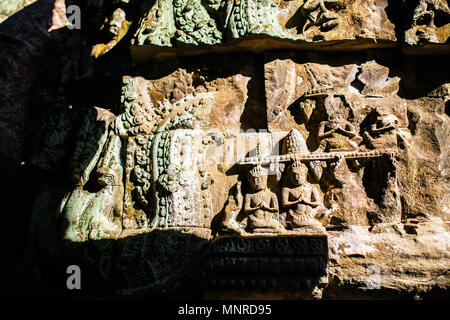 Close up bas reliefs in Angkor Archaeological area temple in Cambodia - Stock Photo