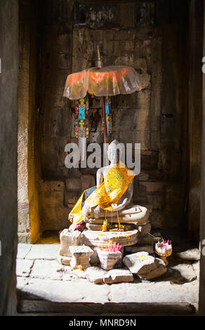 Buddha statue in Bayon temple in Angkor Archaeological area in Cambodia - Stock Photo