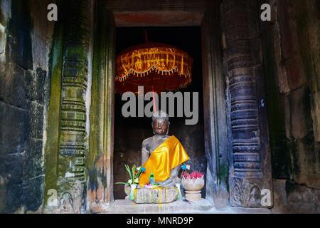 Buddha statue in Angkor Archeological area in Cambodia - Stock Photo