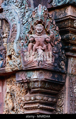 Beautiful Banteay Srei temple carvings in Angkor Archaeological area in Cambodia - Stock Photo