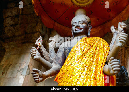Buddha statue in Angkor Archaeological area in Cambodia - Stock Photo