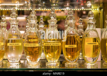 Beautiful glass bottles of perfume sitting on a shelf in Istanbul Spice bazaar in Turkey. - Stock Photo