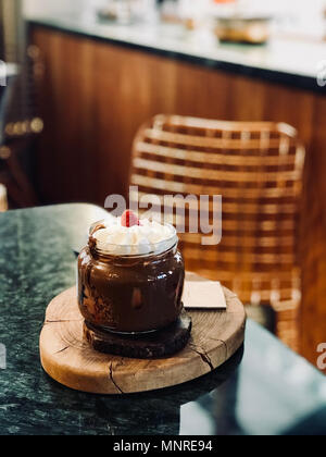 Melted Belgium Chocolate Dessert with Whipped Cream and Strawberry in Jar served at Restaurant. Organic Dessert. - Stock Photo