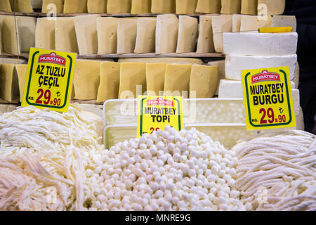 Different types of cheeses on display for sale at Istanbul Spice bazaar in Turkey - Stock Photo