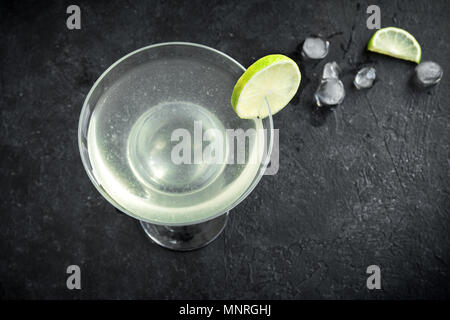 Gimlet Cocktail. Alcoholic Lime and Gin Gimlet on black background, copy space. - Stock Photo