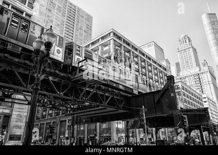 Elevated train track The Loop running down street in Chicago, USA - Stock Photo