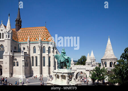 Trinity Square includes the Matthias Church on left and the turrets of the Fisherman's Bastion on the right, on top of Buda Hill, Budapes - Stock Photo