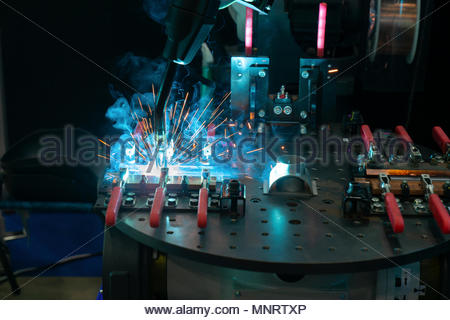 Robot arm in machine tool metalworking process for industry manufacture,CNC metal machining. - Stock Photo