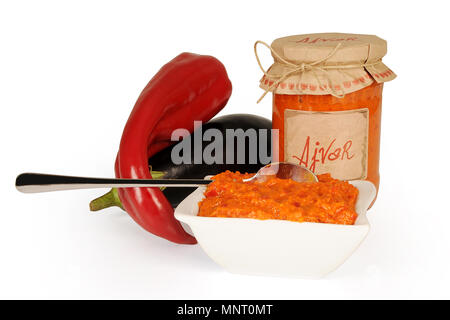 Ajvar, a delicious roasted red pepper and eggplant dish. Serbian and Macedonian traditional dish isolated on white background. - Stock Photo