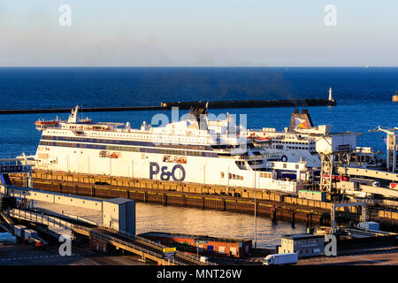 England, Dover harbour. P&O 'Spirit of France' Car ferry unloading trucks and HGVs at ferry terminal. Sunlit by unseen sunrise. - Stock Photo