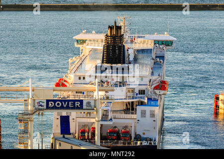 England, Dover harbour. DFDS 'Cote des Flandres' car ferry docking stern end first at terminal. - Stock Photo