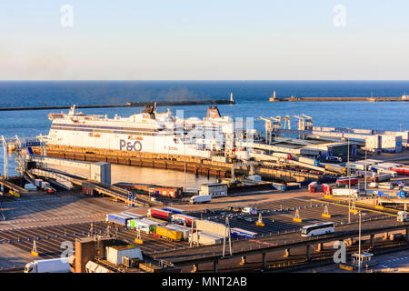England, Dover harbour. P&O 'Spirit of France' Car ferry unloading trucks and HGVs at ferry terminal. Golden hour. Wide angle view of docks. Morning. - Stock Photo