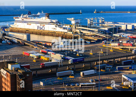 England, Dover harbour. P&O 'Spirit of France' Car ferry unloading trucks and HGVs at ferry terminal. Golden hour. Wide angle view of docks. - Stock Photo