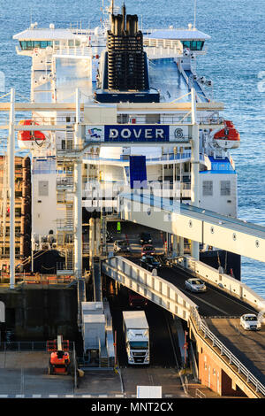 England, Dover harbour. DFDS 'Cote des Flandres' car ferry at terminal unloading cars and trucks. - Stock Photo