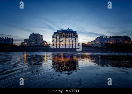 The View Hotel, Eastbourne Seafront from the Beach at Dusk - Stock Photo