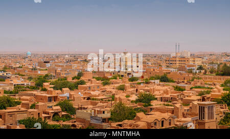 Aerial view of the historic centre of Yazd, Iran. The city is famous for the badgirs, a windcatcher tower as a traditional form of air conditioning - Stock Photo