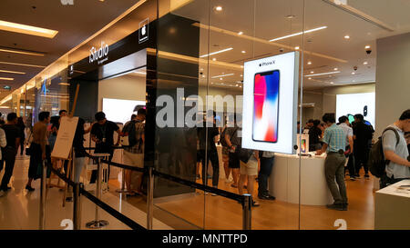 BANGKOK, THAILAND - NOVEMBER 25, 2017: iPhone X is showing at iStudio Shop Siam Paragon shopping mall for a customer to test the new iPhone using expe - Stock Photo