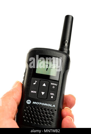 isolated hand holding a walkie talkie - Stock Photo