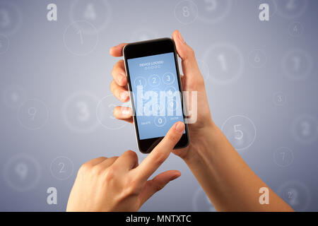 Female fingers touching smartphone with locked device requiring passcode - Stock Photo