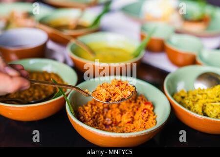 Coconut sambal close up on table with Sri Lankan food - Stock Photo