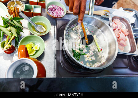 Preparation of traditional Sri Lankan curry dish at cooking class - Stock Photo