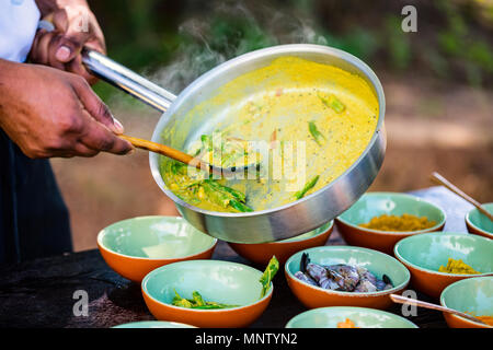 Chef making traditional Sri Lankan curry dish at cooking class - Stock Photo