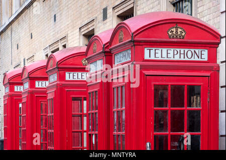 A Row of Red British Telephone Boxes, London, England, UK - Stock Photo