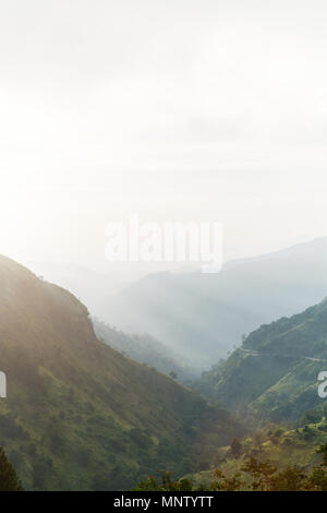 Breathtaking views over mountains and tea plantations from Little Adams peak in Ella Sri Lanka - Stock Photo