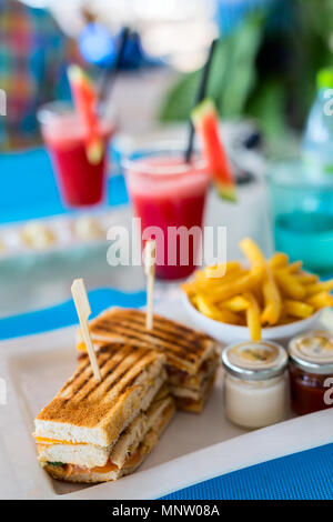 Delicious fresh chicken sandwich and french fries served for lunch - Stock Photo