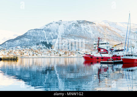 Beautiful winter landscape of snow covered town Tromso in Northern Norway - Stock Photo