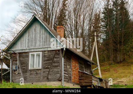 Old-fashioned wooden house on the outskirts of the forest. Among the Carpathian mountains in Ukraine. Outdoors. Close-up. - Stock Photo