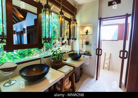 Tropical bathroom interior in a luxury resort - Stock Photo