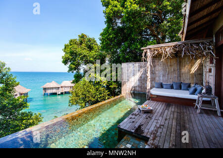 Stylish bungalow with private swimming pool in luxury resort. - Stock Photo