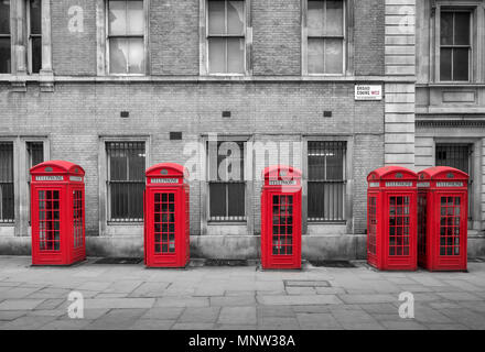 A row of British Red Telephone Boxes, Broad Court, Covent Garden, London, England, UK - Stock Photo
