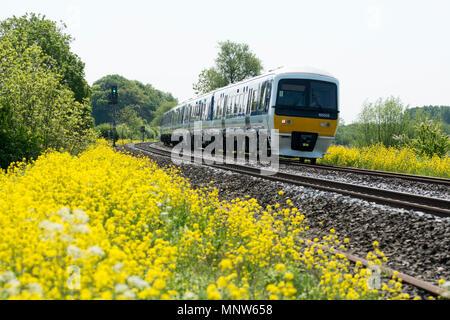 Chiltern Railways class 165 train near King`s Sutton, Northamptonshire, UK - Stock Photo