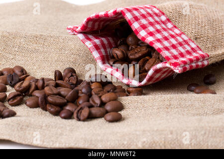 Coffee beans in sack,  burlap background - Stock Photo